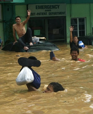 Philippines floods: Residents wait for evacuation from floods in Cainta Rizal, east of Manila