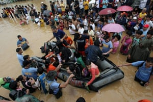 Philippines floods: Filipino rescuers evacuate flood victims in Pasig City, east of Manila