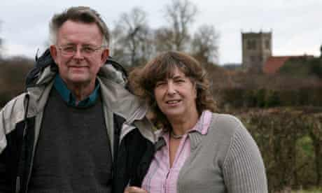 Andrew and Gail Wallbank with their local church in the background.