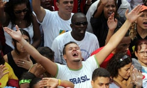 People pray at th Jesus March in Sao Paulo, Brazil