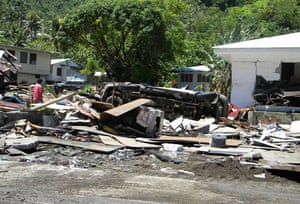 Tsunami in Samoa: An overturned vehicle is stranded among wreckage in the village of Si'umu