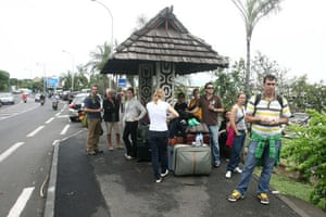 Tsunami in Samoa: People wait for transportation as the Tahiti Faa airport is evacuated