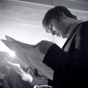 Jane Bown and The Beatles: John Lennon of The Beatles reading a newspaper