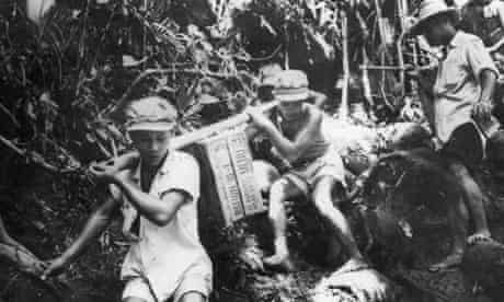 Civilians carry cases of US field rations