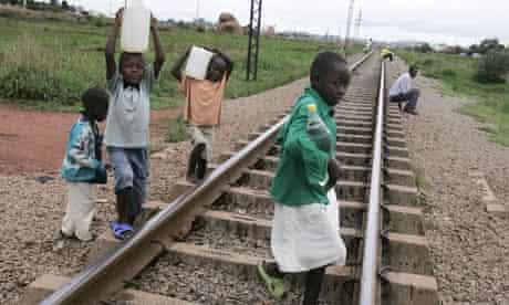 Children collect water in Harare, Zimbabwe