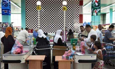 Libyans shop in a hypermarket in Tripoli