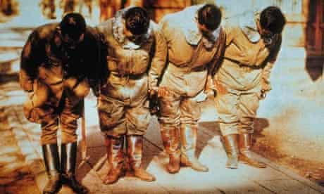 A group of Japanese kamikaze pilots bowing