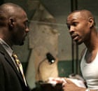 Idris Elba as Stringer Bell and Wood Harris as Avon Barksdale in The Wire.