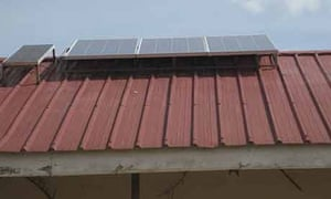 Solar panels fixed on the roof of Ojom health centre in Katine