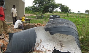 The remains of the split water tank at Ojom health centre in Katine