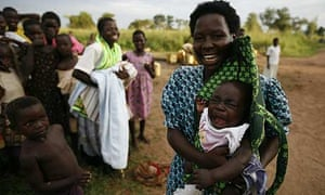 Women and children by a borehole in the Katine sub-county