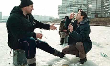 Ice fishermen sip vodka at a lake in Moscow, Russia