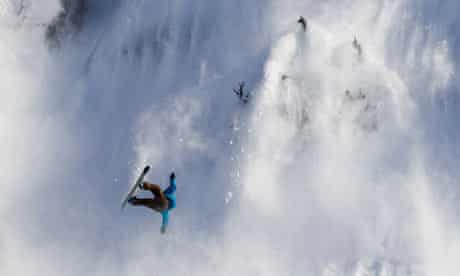 A snowboarder caught in an avalanche