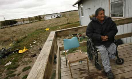 Lawrence Red Feathers sits on his porch at Pine Ridge Reservation, Rapid City, South Dakota, USA