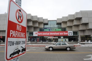 Detroit motor show: A car drives past the entrance of the 2010 North American Auto Show