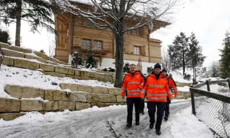 Swiss policemen walk in the Swiss mountain resort of Gstaad
