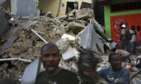 This Twitter image shows Haitians standing amid the rubble in Port-au-Prince