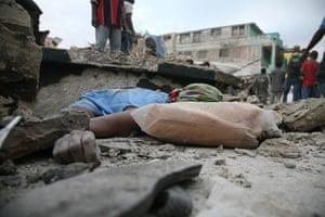 Haiti earthquake: A body lies amid rubble in Port-au-Prince
