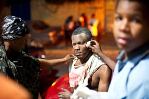 haiti update: Major Earthquake Hits Haiti People come to the aid of a wounded man