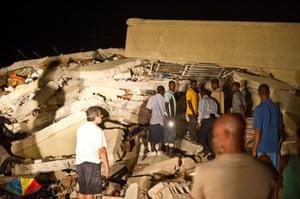 haiti update: Major Earthquake Hits Haiti People search for survivors amongst the rubble