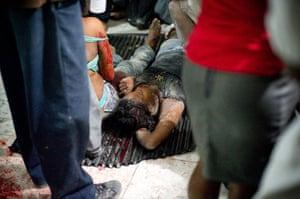 haiti update: Major Earthquake Hits Haiti Women wait on the floor at the emergency clinic