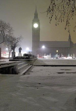Snow again: A fresh fall of snow blankets London's Parliament Square