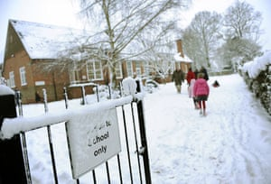 Snow again: Children make their way to class at Oakwood Infant School, Hartley Wintney
