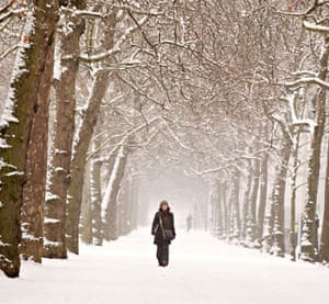 Snow again: A woman walks through St James's Park in central London