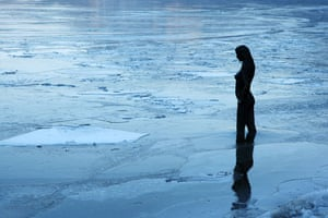24 hours: Chuncheon,  South Korea: A statue is surrounded by ice near the North Han River