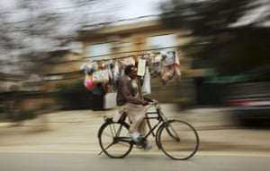 24 hours: Islamabad, Pakistan: A toy seller rides his bicycle