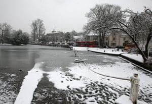 Snow again: Traffic passes half frozen Carshalton Ponds