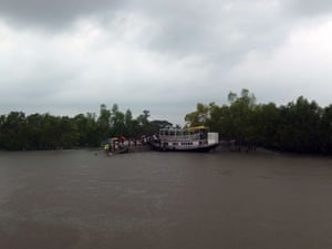 Sinking Sundarbans: Villagers await food relief supplies randomly distributed by local NGOs