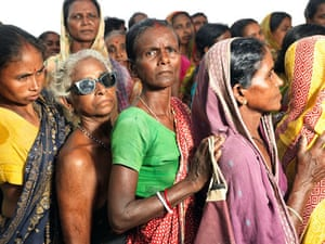 Sinking Sundarbans: Women stand in a queue to receive emergency relief supplies
