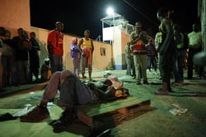 haiti update 2: A injured resident waits for medical attention earthquake in Port-au-Prince