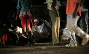 haiti update 2: Residents rest on the street after an earthquake in Port-au-Prince