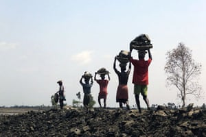 Sinking Sundarbans: Villagers desperately try to build higher and stronger dykes as a barrier