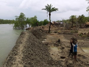 Sinking Sundarbans: The new river bank barely holds the river's high tide in Saheb Ghat Village