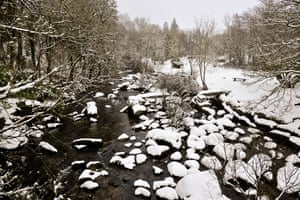 Snowing again: The river Dart at Dartmeet on Dartmoor
