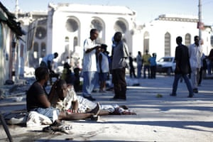 haiti update 3: Injured people rest outside Port-au-Prince's cathedral after an earthquake