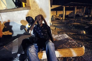 Haiti earthquake: Gunsly Milsoit, left, comforts his brother-in-law Leo Pierre