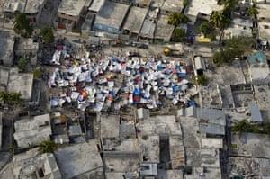 Haiti earthquake: Haitians set up impromtu tent cities thorough the capital
