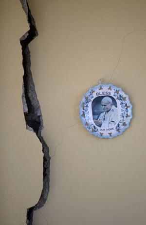 haiti earthquake: image of pope in earthquake damaged house