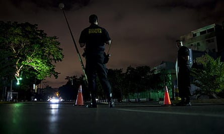 Police officers control traffic during a partial blackout in Caracas, Venezuela