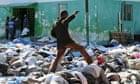 A man makes his way through bodies in Port-au-Prince, Haiti