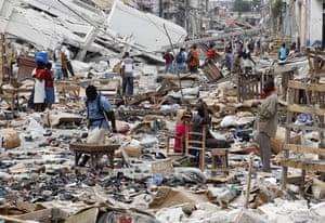 haiti quake: Residents through the devastation in Port-au-Prince