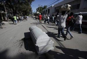 haiti quake: A coffin containing the body of an earthquake victim