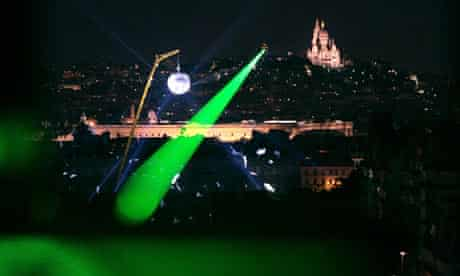 A laser beam over Paris. This year is the 50th anniversary of the first Laser beam.