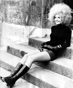 Teenage Hair: A white girl with afro style hair sits on steps