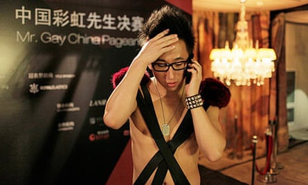 Contestant Simon Wang hears the Mr Gay China contest has been cancelled.