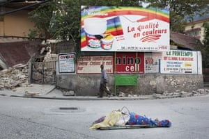 David Levene in Haiti: A body lies in the middle of the road awaiting collection in Canape Vert
